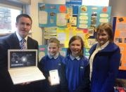 "Minister Damien English with Ashley Dunne, Koby Fowler and their teacher Mary Cook-McCarthy from Newtown National School, Newtown, Enfield, Co Meath. Ashley and Koby were runners up at the Intel Mini Scientist National Final with their project ""How To Fight Kids Obesity"" in Trinity College Dublin."