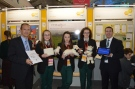 Minister Damien English & Peter Evans of BT join Emma McCabe, Zoe Maguire & Edel Campbell of St Oliver Post Primary, Oldcastle at the 51st BT Young Scientist Exhibition in the RDS