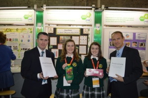 Minister Damien English & Peter Evans of BT join Aoife O'Donnell & Georgina Dillon of St. Peter's College, Dunboyne at the 51st BT Young Scientist Exhibition in the RDS