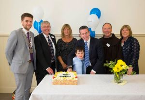 """22/07/2016. FREE TO USE IMAGE. Pictured on Friday 22nd July, at the official opening of  John's College Redevelopment. Pictured cutting the cake are Mayor of Waterford City and County, Cllr Adam Wyse, Tom Power, Respond Support, Sen. Grace O'Sullivan, Damien English T.D. Minister of State for Housing and Urban Renewel and his son Harvey, Fr. Pat Cogan ofm, Founding Director of Respond! and Cllr. Mary Butler. Picture: Patrick Browne Formal Opening of John's College Redevelopment  Stage One Completed: Ten Years of Redevelopment Planning/Construction is now completed.  On conclusion of the acquisition and planning, the actual re-construction of John's College began in March 2014 by Respond! Ltd and was completed in November 2016 by Mythen Construction, ahead of schedule. The impressive development includes 21 new apartments in the College, with a 10-bed group home and 36 new-build one-bed apartments overlooking the Folly. The total redevelopment costs came to €12 million. All of the residents in John's College came from the Waterford City and County Local Authority waiting list. The apartments cater mainly for Older People and people with specific needs and requirements who are capable of independent living.  On Friday 22nd July, the Minister of State for Housing and Urban Renewal, Damien English, T.D. performed the official opening of the John's College campus in Waterford with a large crowd of distinguished guests in attendance. The Bishop of Waterford and Lismore, Very Reverent Alphonsus Cullinan and Dean Maria Jansson carried out a blessing of the campus. The recently elected Mayor of Waterford City and County, Cllr. Adam Wyse was in attendance and was highly impressed with the redevelopment.  According to the John's College Facilities Co-ordinator, David Phelan: """"All of the residents have now moved in and are very happy with their accommodation and the support services offered in John's College. We are currently running a number of"""